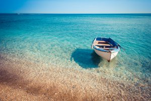 Typical greek small boat in the sea.